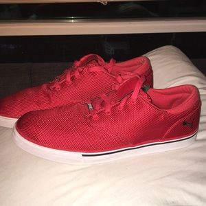 Used red puma shoes size 12